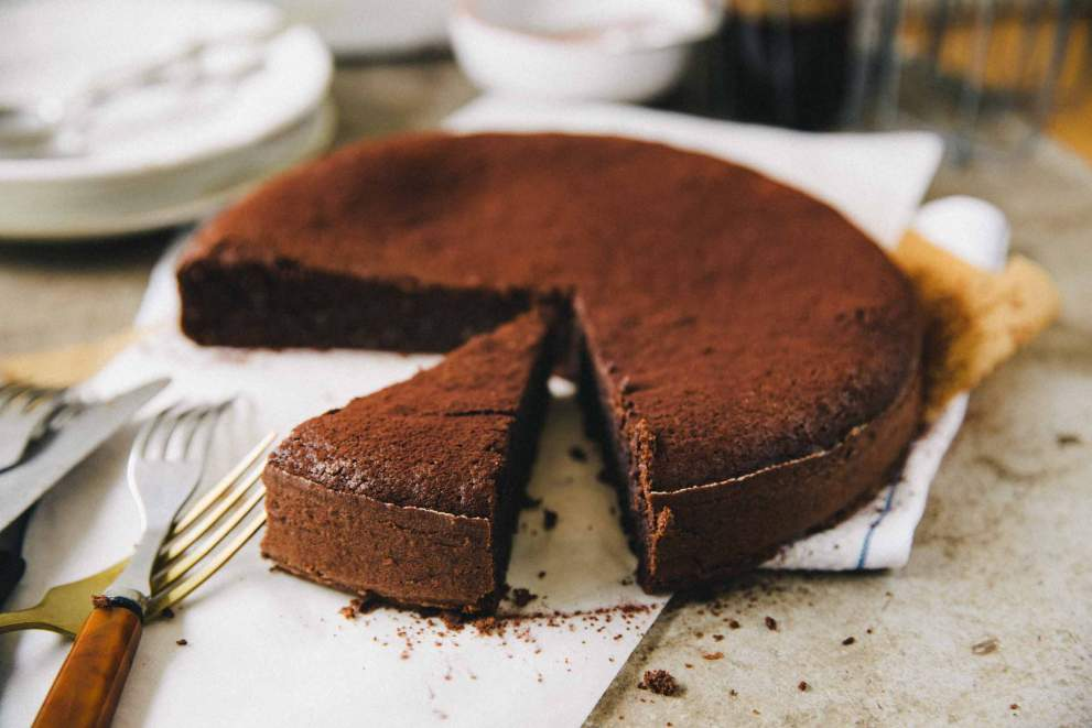 Flourless espresso chocolate cake ready to be served