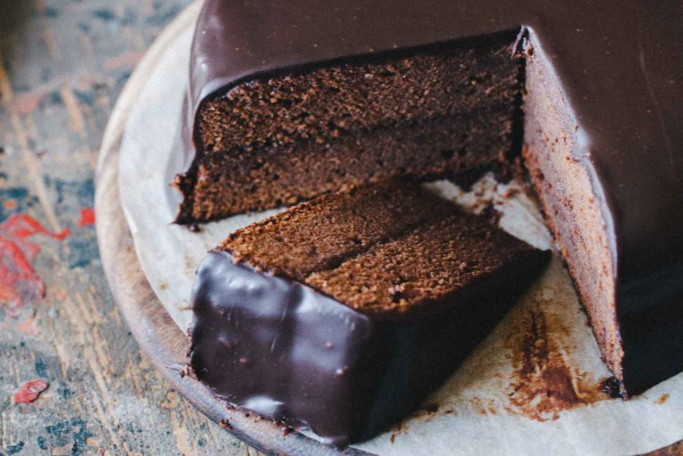 Sacher torte cut on slices with layers of chocolate and marmelade