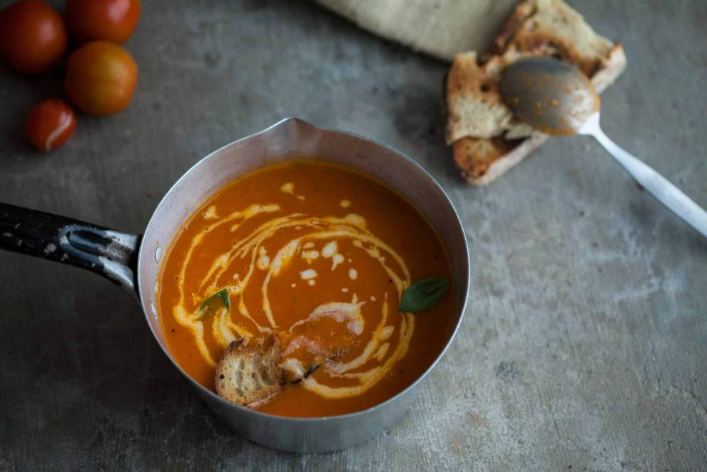 tomato soup with garlic cream in a pot