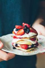 The fluffiest Pancakes served with strawberries and blueberries