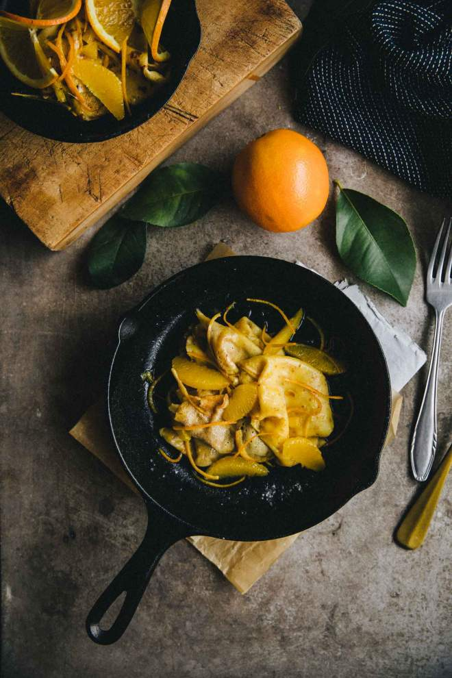 Crêpes with silky orange sauce served in a skillet