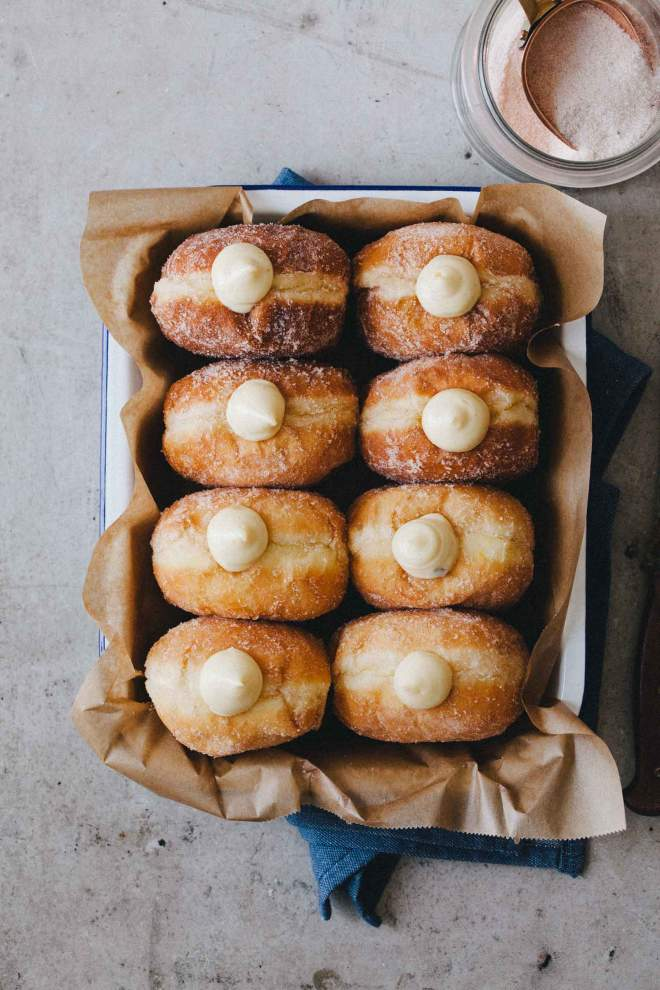 Soft Homamde Doughnuts with rich vanilla cream on a baking dish
