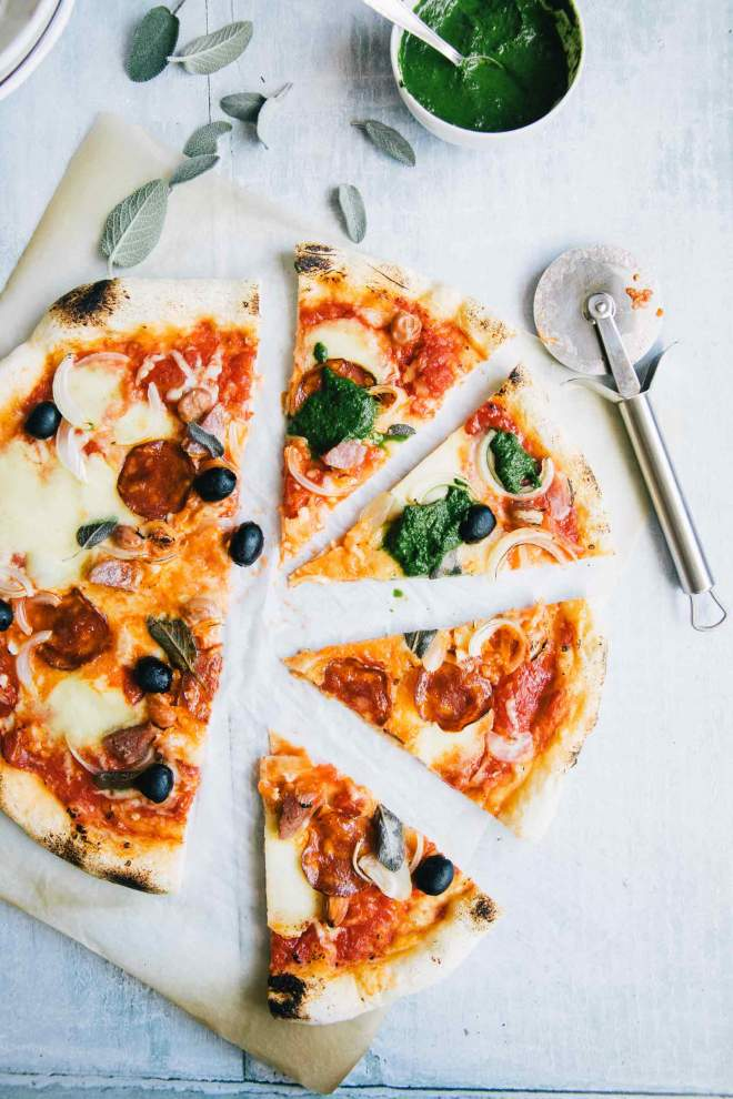 Fall pepperoni pizza with onion and sage