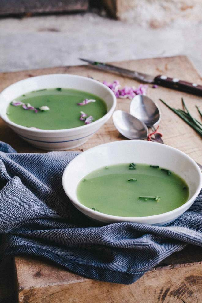 Nettle soup with chives served in a bowl