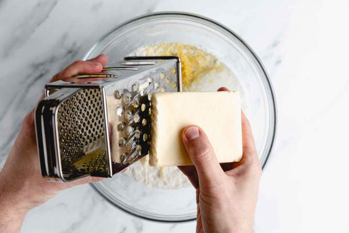 Grating butter for Lemon Blueberry Scones with Poppy Seeds