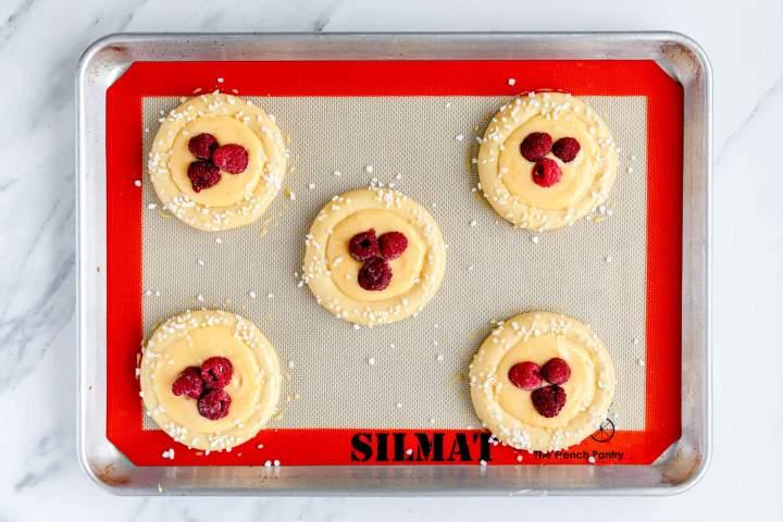 Vanilla Brioche Buns with Raspberries before baking