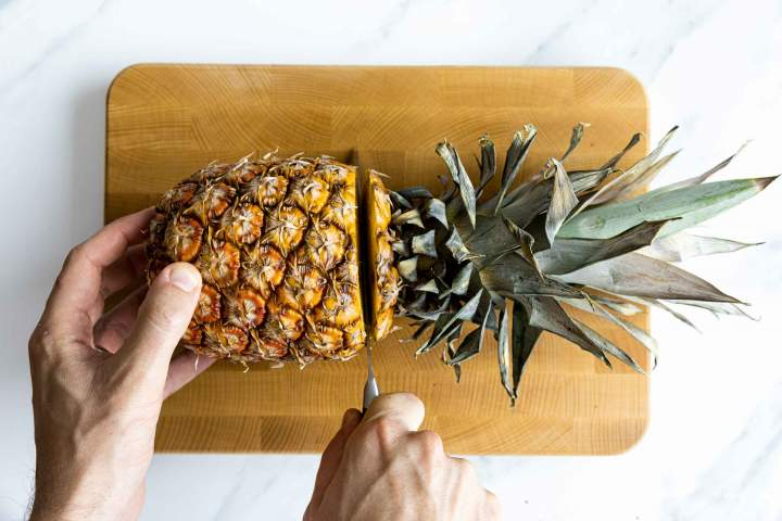 Cutting a fresh pineapple for Pineapple sorbet
