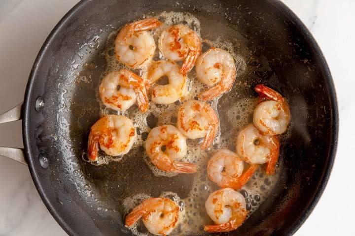 Frying shrimp for Ginger Scallion Noodles with Shrimp
