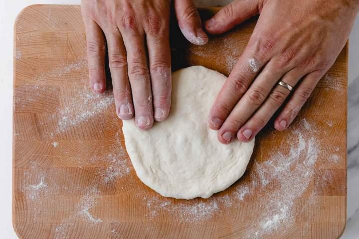Shaping the dough into Lepinja (Balkan Flatbread)
