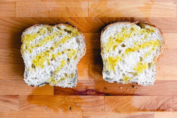 toasting bread for Whipped Ricotta Tomato Toast