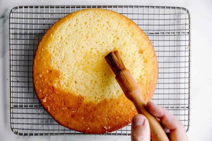 brushing the sponge cake with liquid
