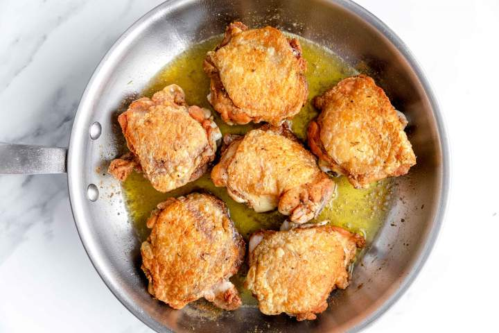 Pan-frying the meat for Oven-Baked Chicken Thighs with Carrots