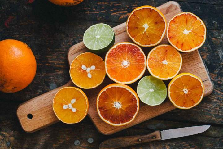 Fresh citrus cut in half on a wooden table