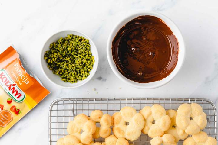 Dipping Spritz cookies in melted chocolate