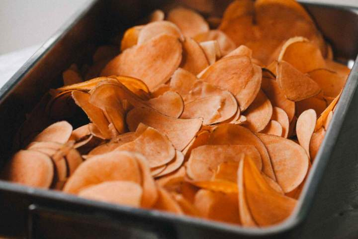 Slices sweet potatoes ready to be baked