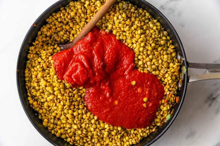 Adding tomato passata to Lentil Bolognese