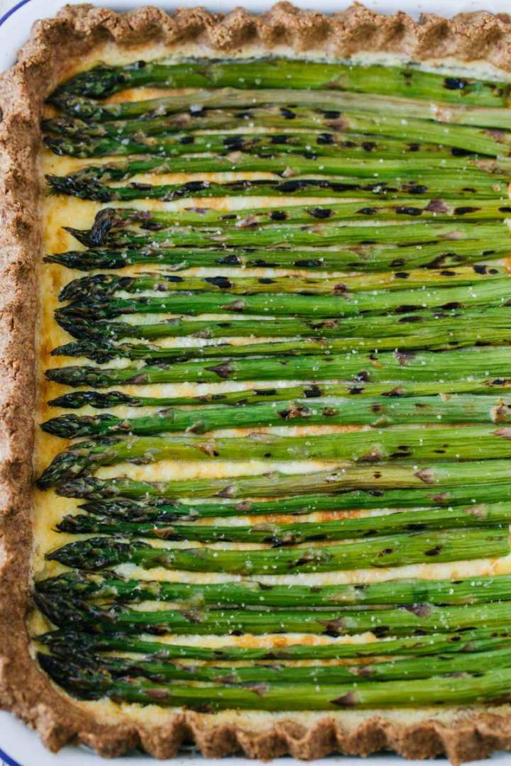 Super creamy Asparagus and Ricotta Tart served in a baking dish