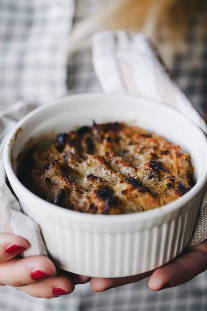 Baked bread stuffing in a bowl held in hands