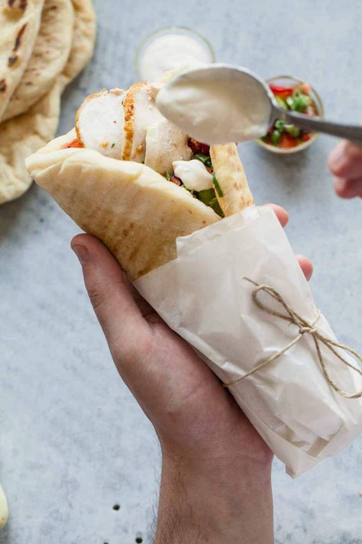 Chicken wraps with fresh salsa and yogurt served in a flatbread
