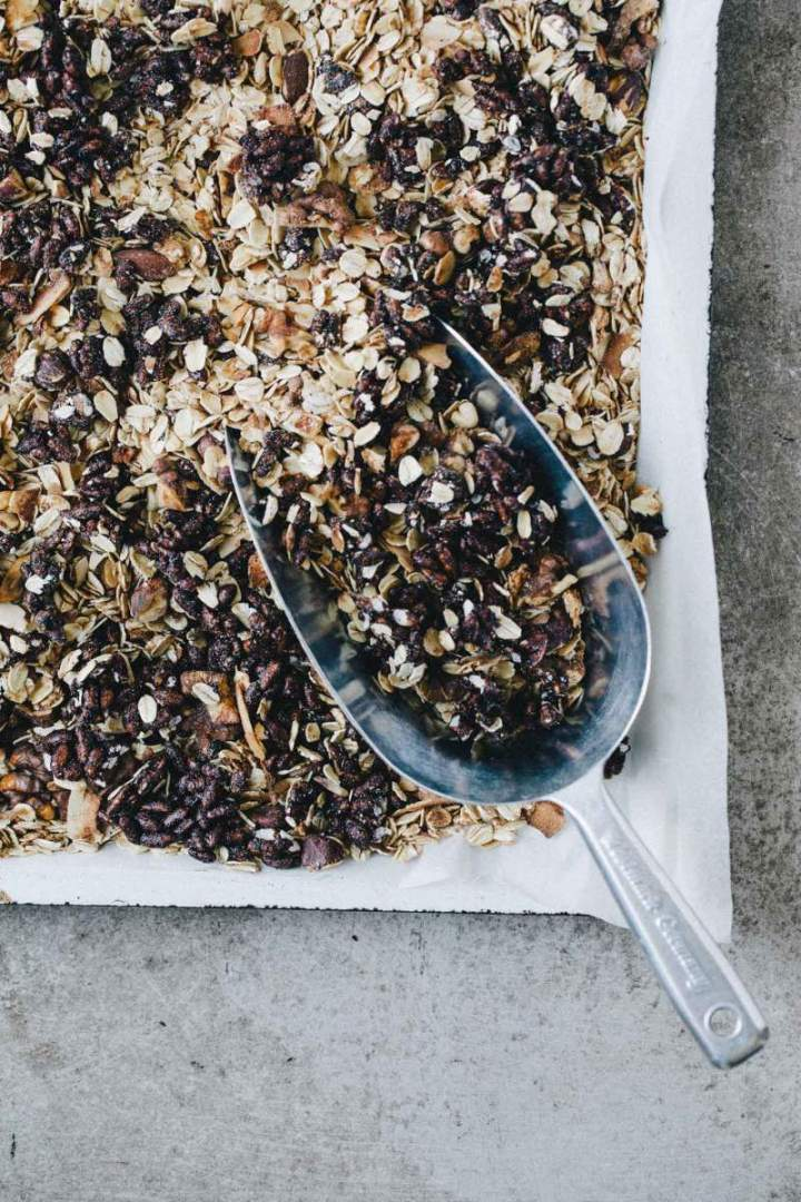 Dark chocolate granola with rice puffs on a baking sheet