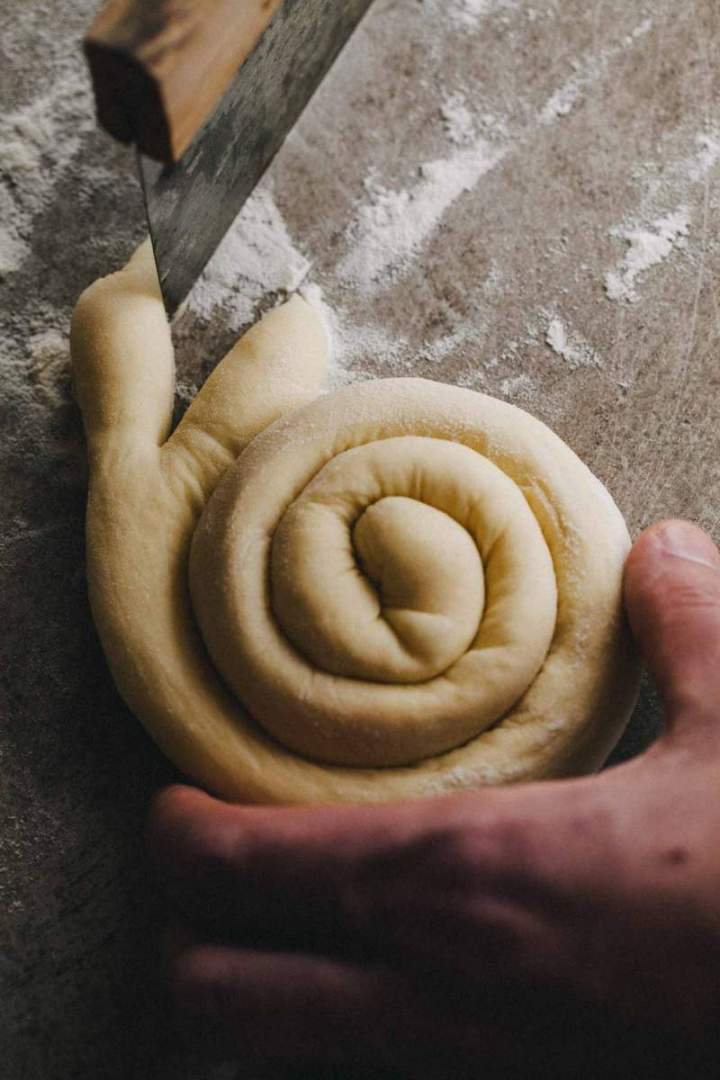 Shaping Easter bunny shaped rolls