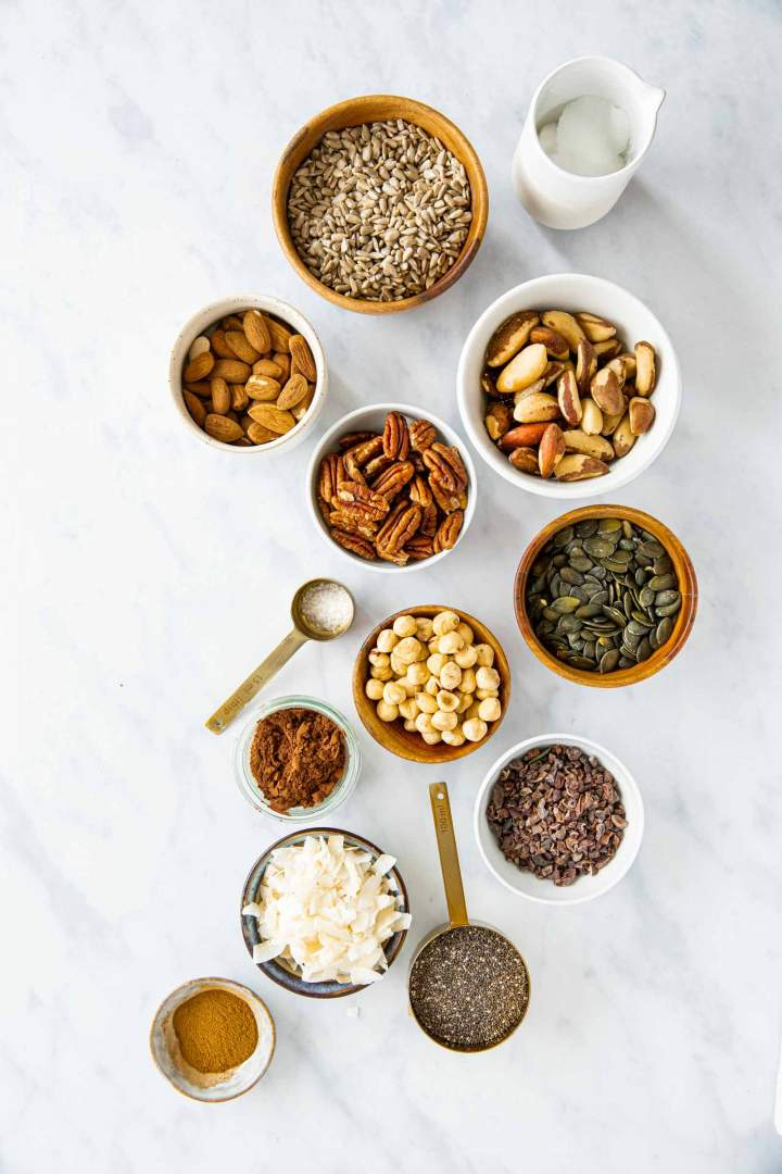 Ingredients for a homemade keto granola, seeds, nuts, coconut, cocoa