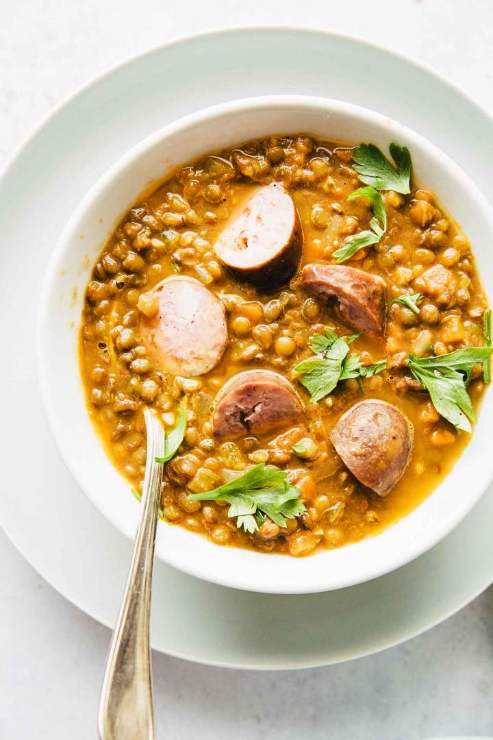 Lentil stew with indian spices and sausage