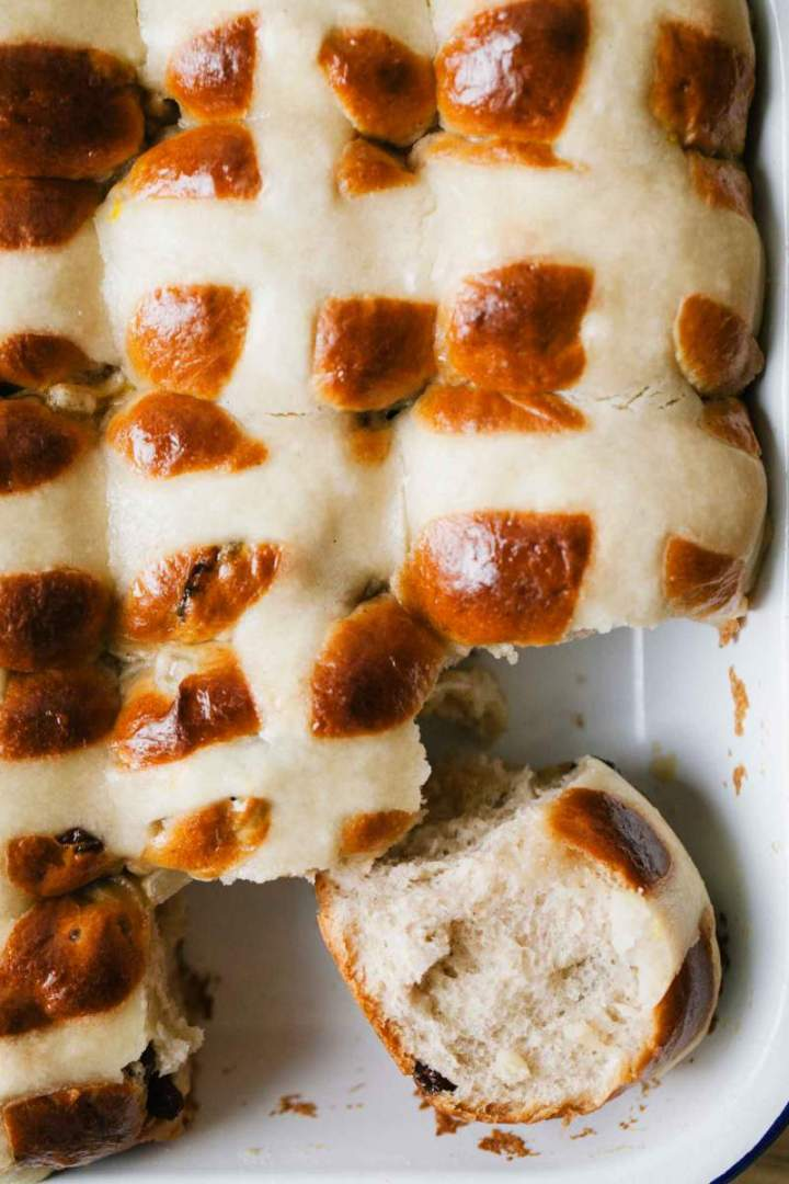 Baked hot cross buns in a baking dish