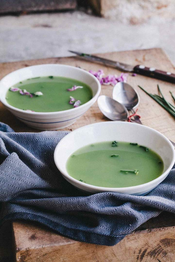 nettle soup with chives served in bowls