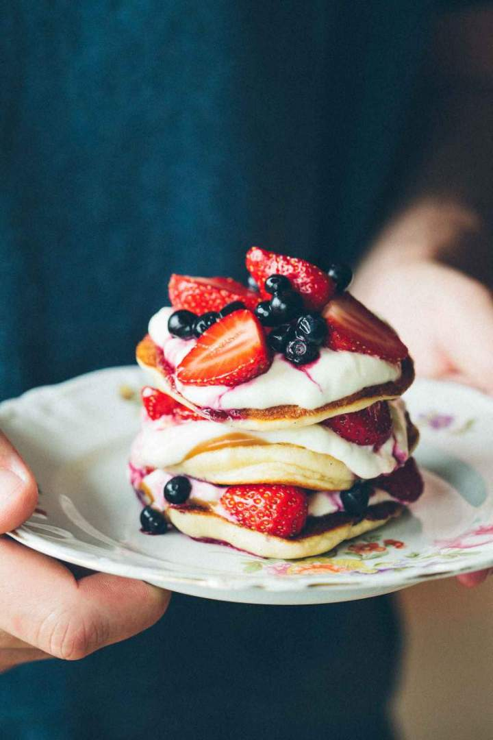 The fluffiest pancakes with strawberries and blueberries