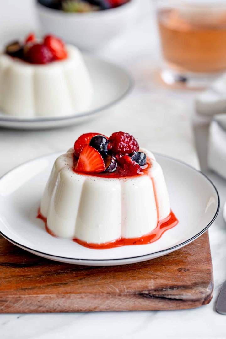 Classic Vanilla Panna Cotta served with macerated berries