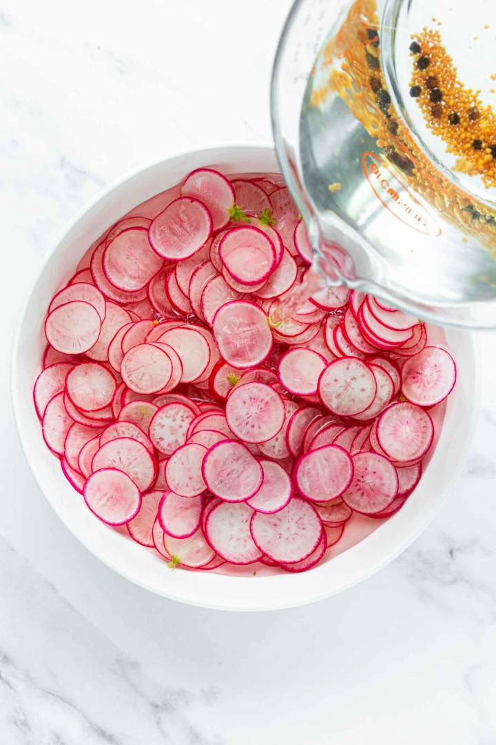 Covering the radishes with liquid for Quick Pickled Radishes