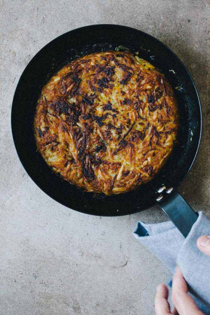 Rösti (potato and zucchini fritters) in a pan