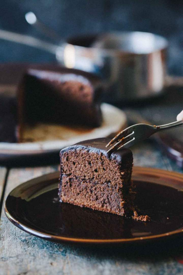 Sacher torte cut on slices with layers of chocolate and marmalade
