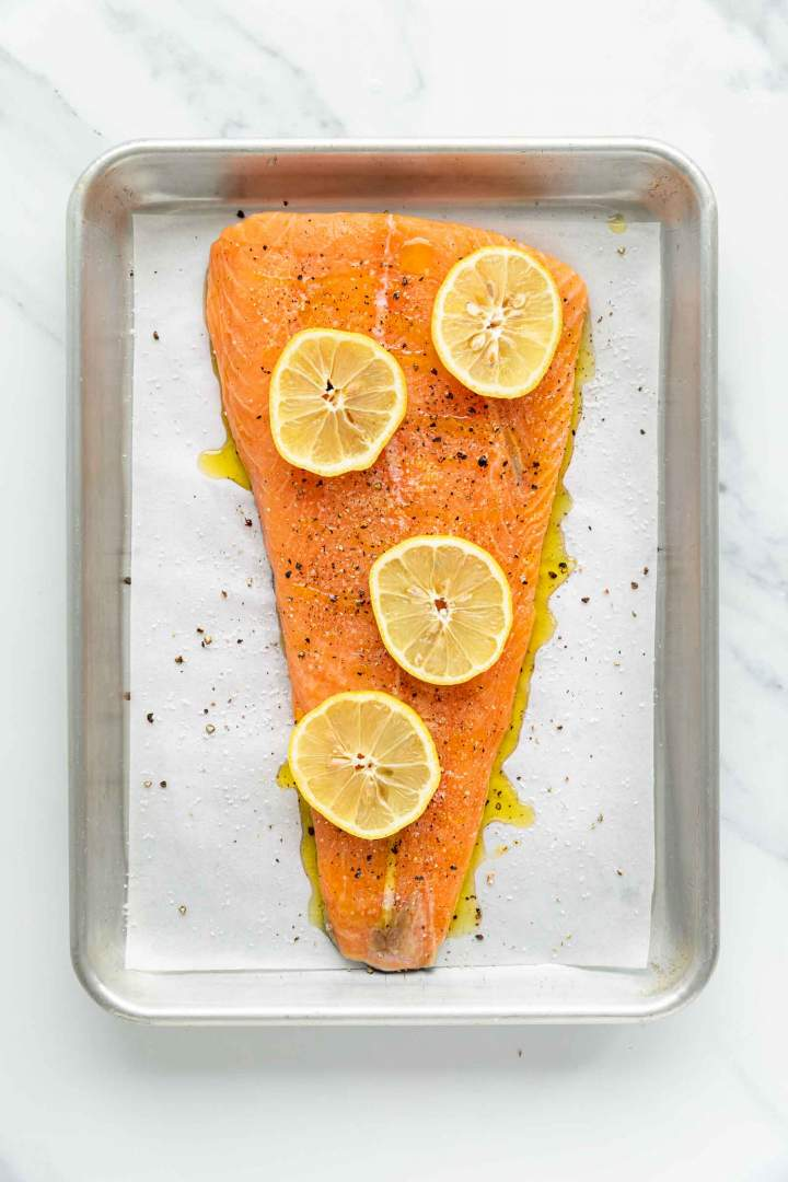 Salmon fillet with lemon before baking