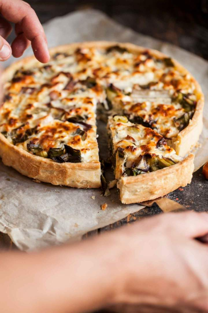 Slice of Soft cheese and vegetables tart