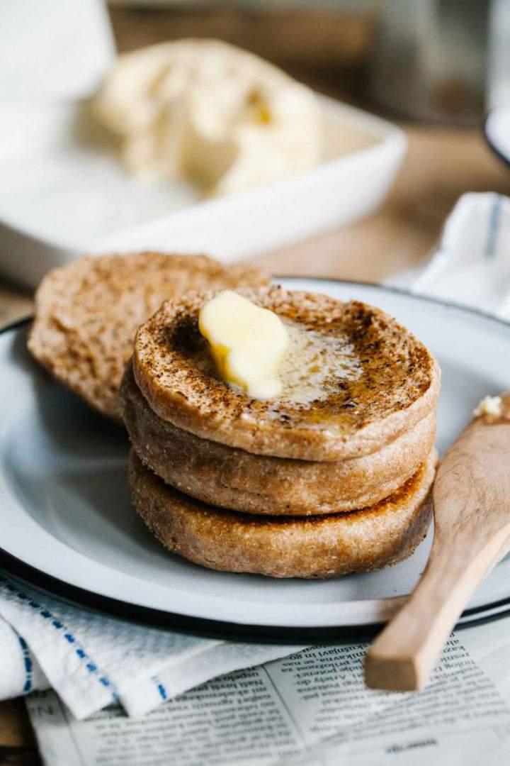 Spelt english muffins freshly baked and spread with butter