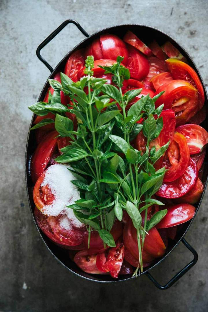 Fresh tomatoes and basil in a large pot | jernejkitchen.com