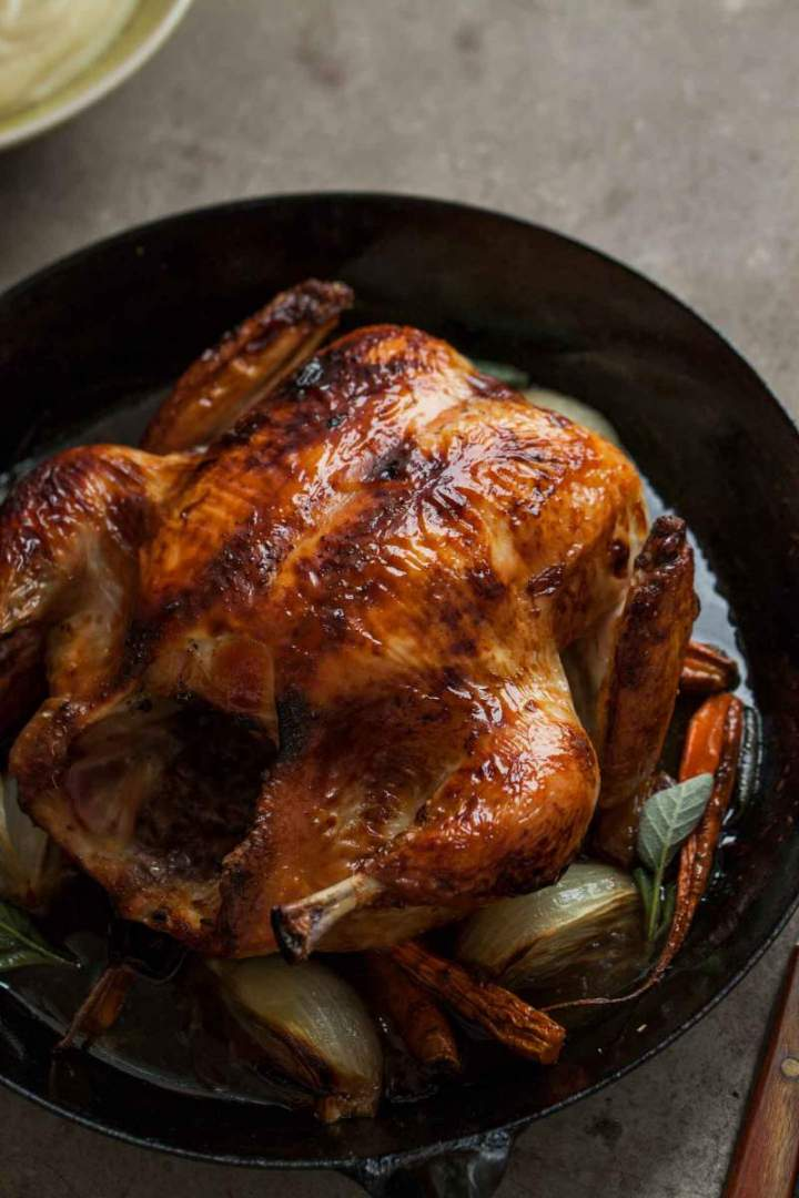 Juicy Whole roasted chicken with black chai glaze